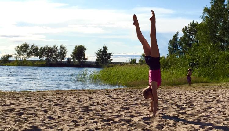handstand beach finland yoga
